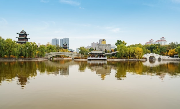 In autumn, ancient buildings and arch bridges are in yingze park, taiyuan