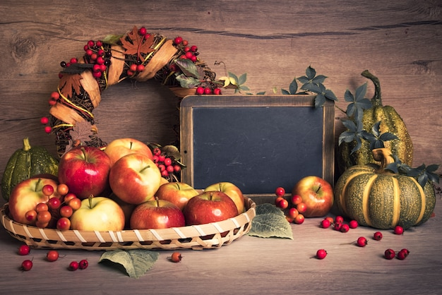 Autumn arrangement with apples, decorations and text space