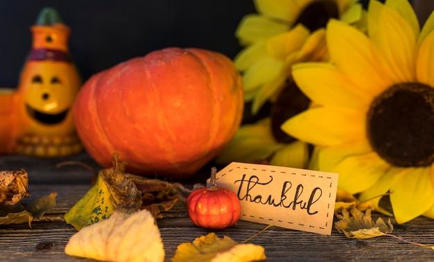 Autumn arrangement with sunflower and pumpkin