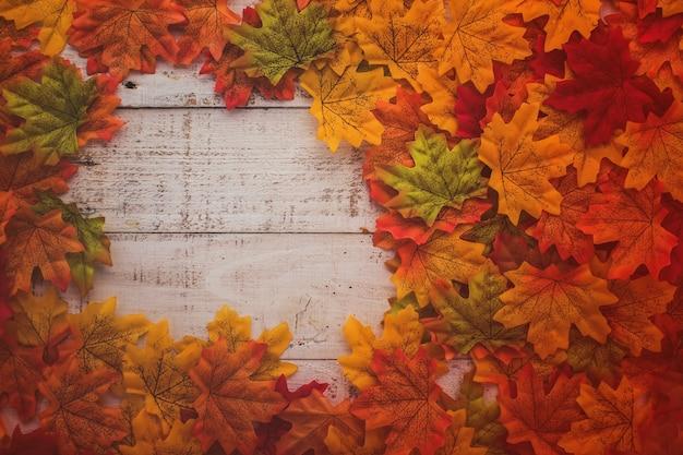 Autumn background border leaf on old white vintage wooden floor