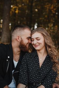 Autumn background and loving couple