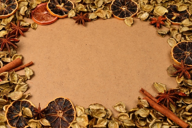 Autumn background with golden leaves, dried fruits, cinnamon and anise star
