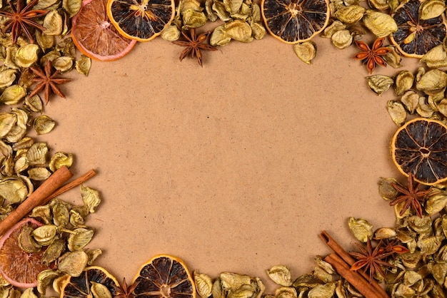 Autumn background with golden leaves, dried fruts, cinnamon and anis.
