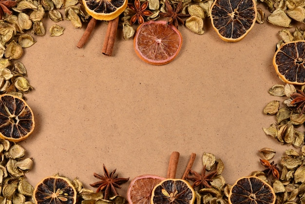 Autumn background with golden leaves, dried fruts, cinnamon and anis