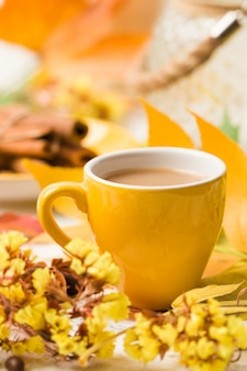 Autumn banner with cup of coffee with cinnamon on white wood