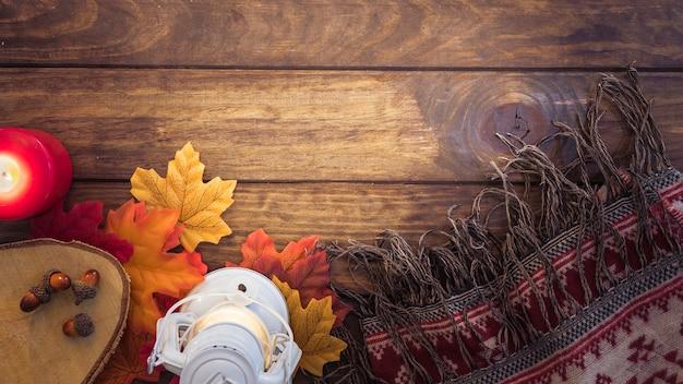 Autumn blanket and lantern composition