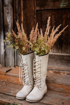 Autumn bouquet in rubber boots