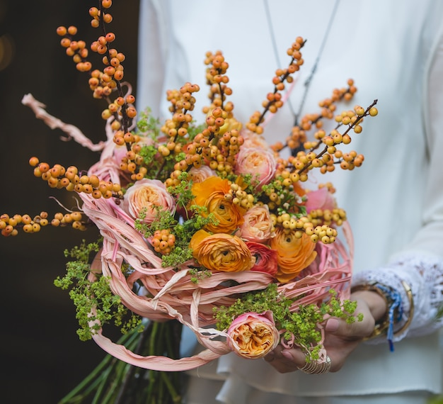 Autumn bouquet with yellow roses and berries