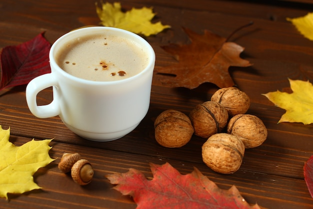 Autumn breakfast: cappuccino, croissant and chocolate