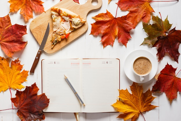 Autumn breakfast with coffee, pizza and diary. top view concept