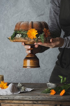 Autumn bundt cake with pumpkin on rustic table