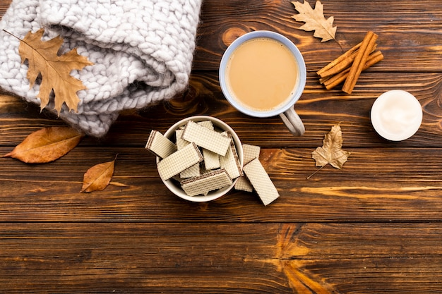 Autumn coffee and wafers layout on wooden background