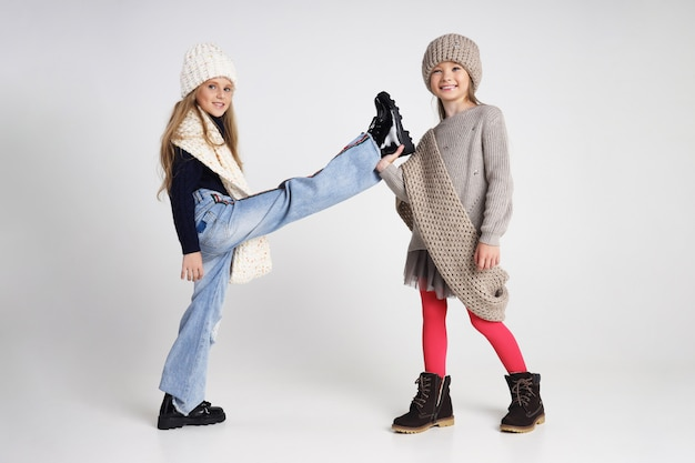 Autumn collection of clothes for children and teenagers. jackets and coats for autumn cold weather. children pose