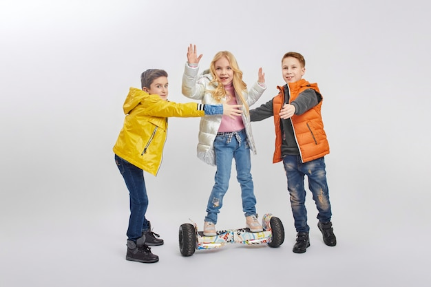 Autumn collection of warm clothes for children. jackets and down jackets clothing for children