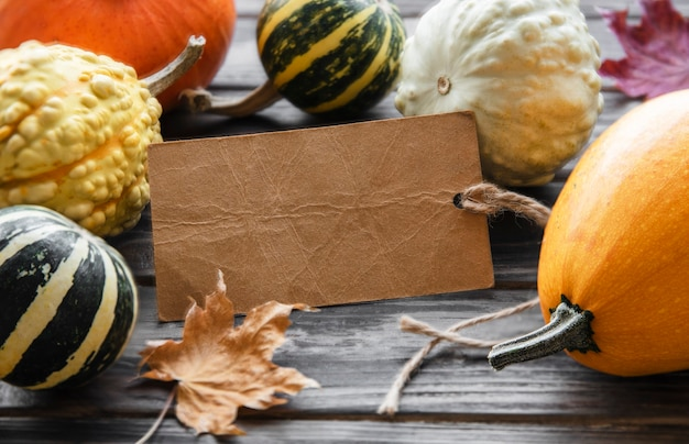 Autumn composition,  cozy fall season,  pumpkins and leaves on wooden background. symbol of thanksgiving holiday,  flat lay