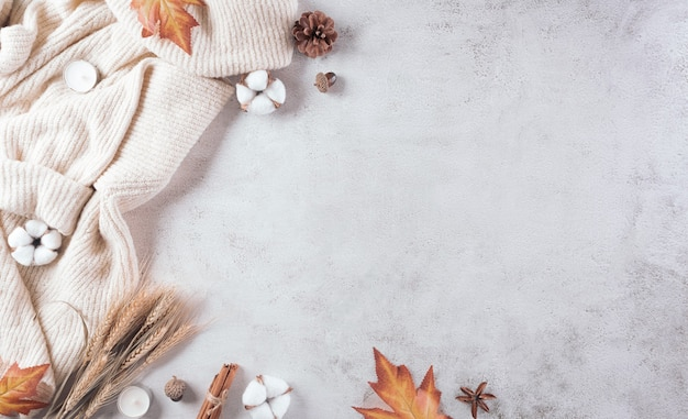 Autumn composition a cup of coffee cotton flowers autumn leaves and sweater on stone