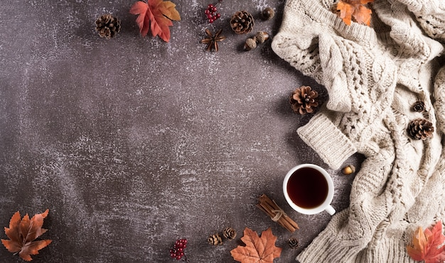 Autumn composition a cup of coffee cotton flowers autumn leaves and sweater
