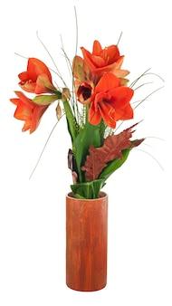 Осенняя композиция из цветов амариллиса в керамической вазе изолирована