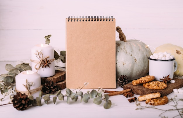 Autumn composition mockup cocoa marshmallows cookies pumpkin and candles