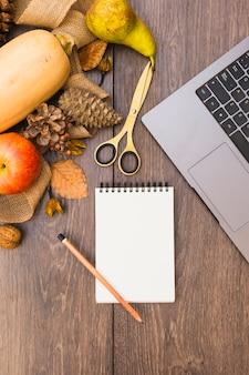Autumn composition of notepad with vegetables