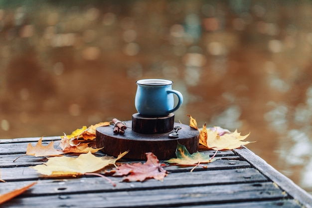 Autumn composition outdoor. autumn. a cup of hot coffee outdoor.