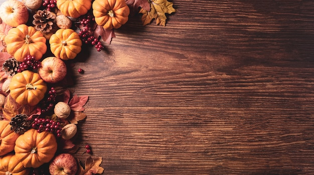 Autumn composition pumpkin cotton flowers and autumn leaves on dark wooden