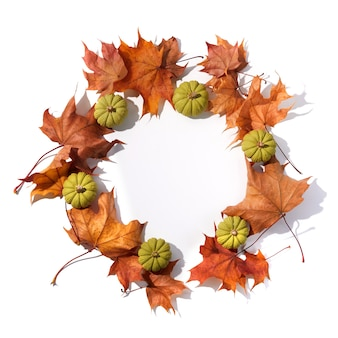 Autumn composition. round frame from dried leaves and pumpkins on white background. top view. flat lay.