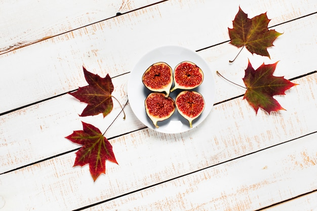 Autumn composition. top view of figs and autumn leaves.