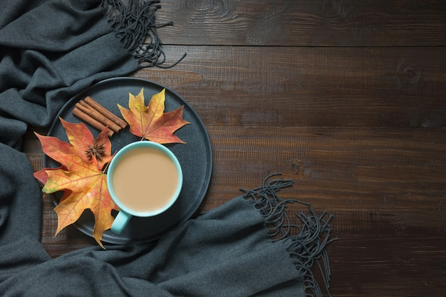 Autumn composition with cup of coffee,