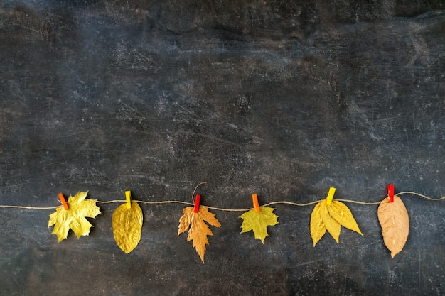 Autumn composition with golden leaves