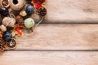 Autumn composition with harvest and clews on wooden background