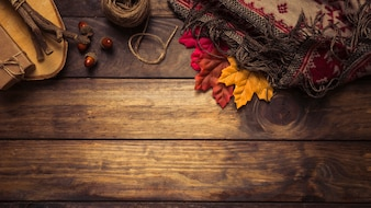 Autumn composition with leaves and blanket