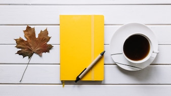 Autumn composition with minimal workspace on white wooden background