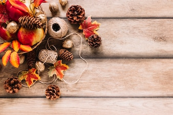 Autumn composition with pine cones, clews and apples