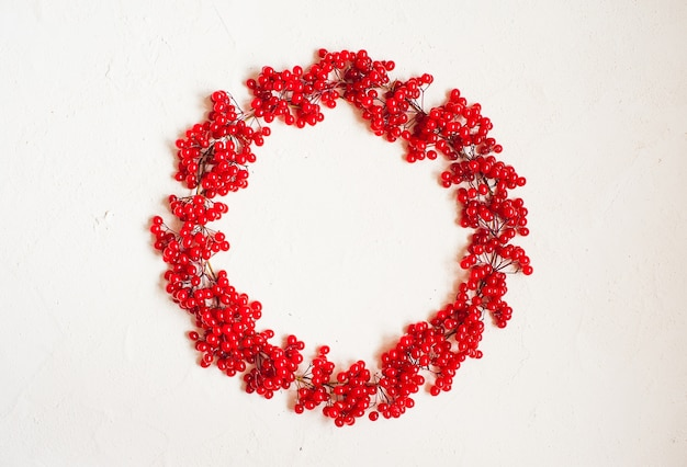 Autumn composition with red berry. wreath made of viburnum berries.