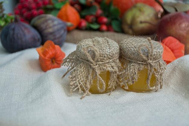 Autumn concept. honey in small jars.