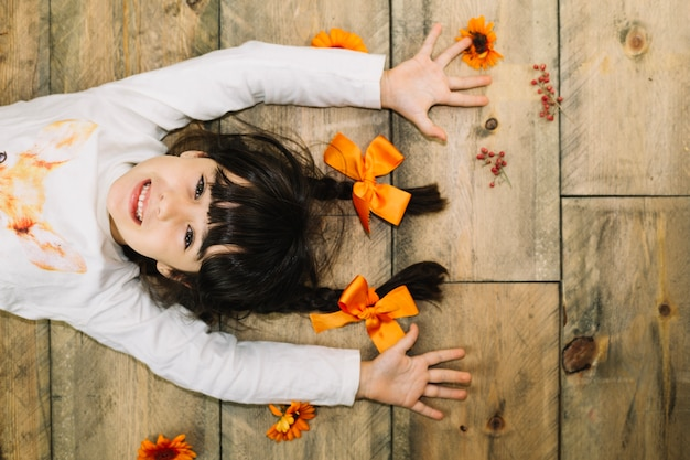 Autumn concept with smiling girl on floor