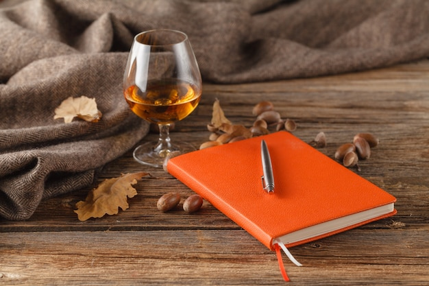 Autumn drinking time with alcohol glass