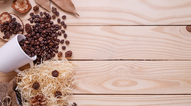 Autumn dry leaves on wooden brown background top view