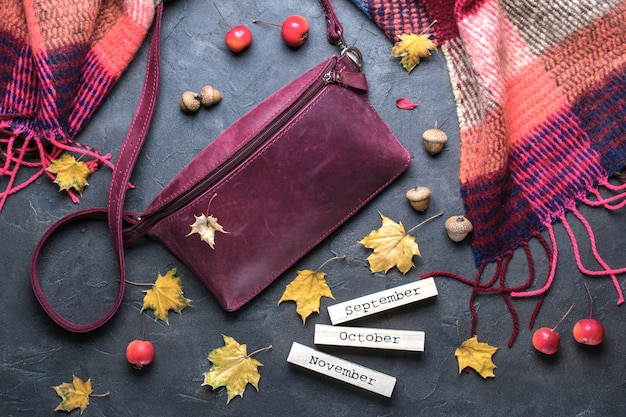 Autumn, fall concept. flat lay, top view. autumn frame with accessories, yellow leaves and wooden calendar