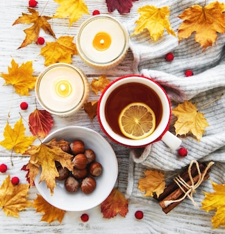 Autumn flat lay with cup of tea and leaves