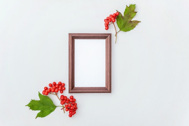 Autumn floral composition. vertical photo frame viburnum berries