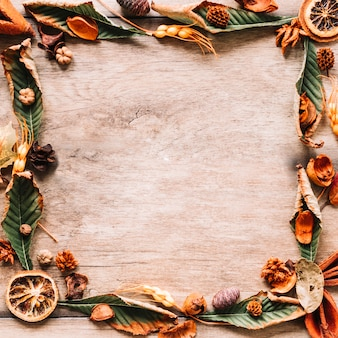 Autumn floral frame composition on wooden background