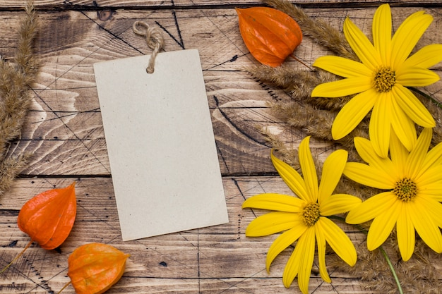 Autumn flowers and notepad