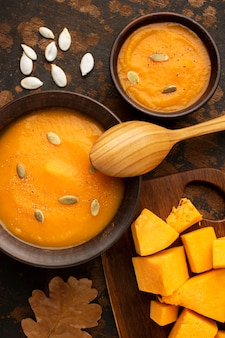 Autumn food soup and pieces of pumpkin