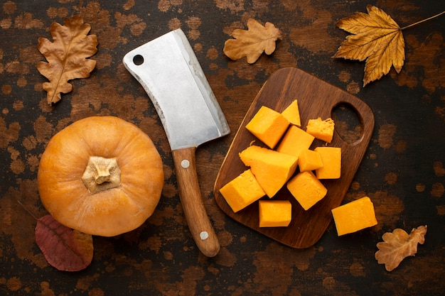 Autumn food with cleaver knife and pumpkin