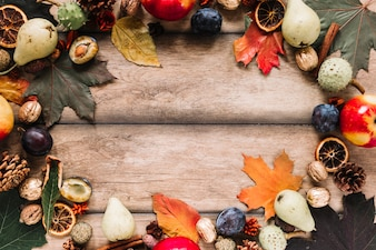 Autumn frame composition with harvest on wooden background