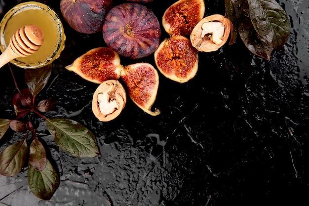 Autumn fruits on a dark table