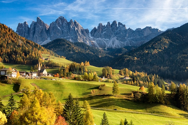 Autumn funes valley and old chapel santa maddalena in val di funes in italy
