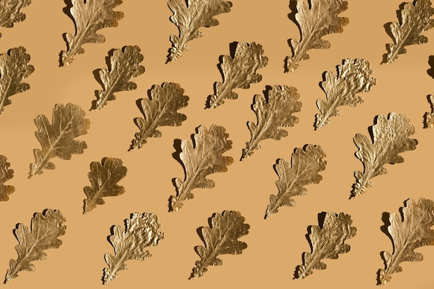 Autumn golden marple leaves on beige, flat lay